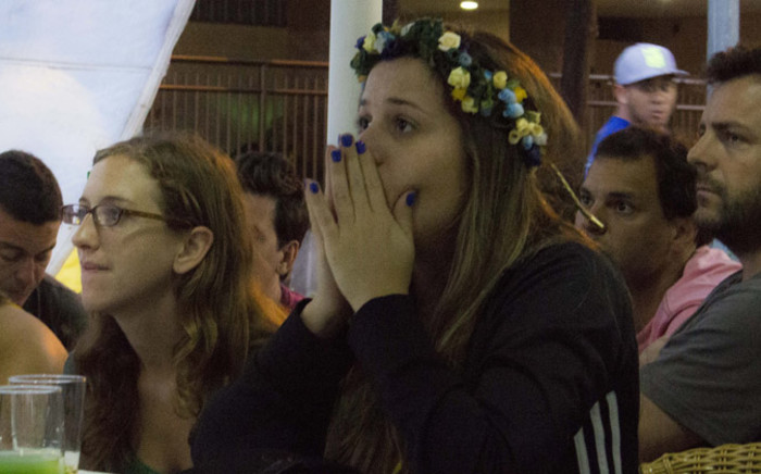 Brazil fans watch in shock as their country was knocked out of the World Cup after they were beaten 7-1 by Germany in the semi-finals on 8 July 2014. Picture: Christa Eybers/EWN.