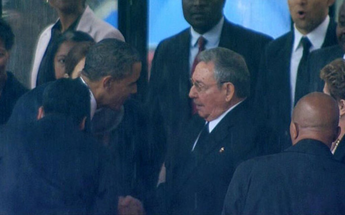 US President Barack Obama greets Cuban President Raul Castro ahead of his speech at FNB during Nelson Mandela's memorial on 10 December 2013. Picture: @lordrich6 via twitter