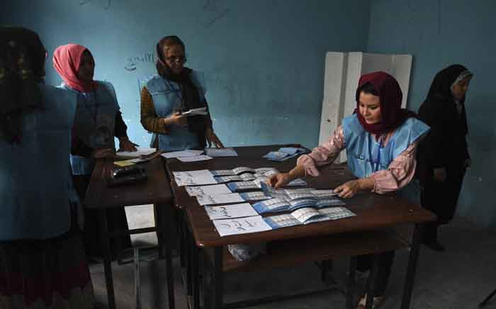 Afghan Independent Election Commission officials count ballot papers after polling stations closed, in Mazar-i- Sharif on 28 September 2019. Picture: AFP