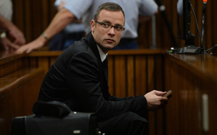 Oscar Pistorius on the day 10 of his murder trial at the High Court in Pretoria on 14 March 2014. Picture: Pool.