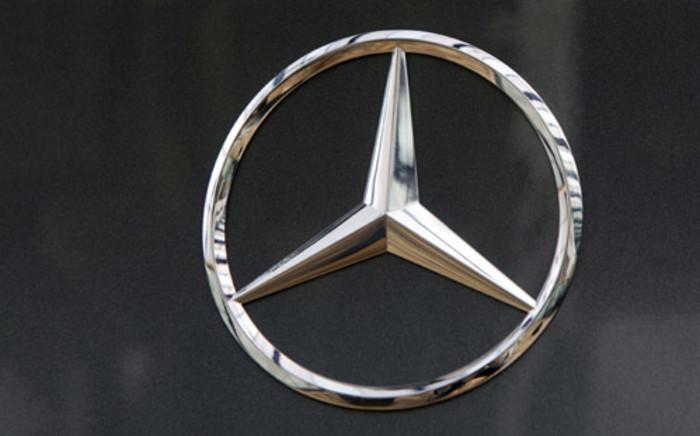 Daimlers brand Mercedes Benz, at a car dealer in Rueil-Malmaison, outside Paris. Picture: AFP.