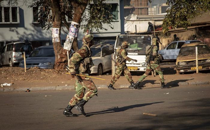 Army officials patrolled the streets during election protests in Zimbabwe on 1 August 2018. Picture: Thomas Holder/EWN