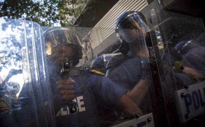 Saps forms a barricade against Cosas members on Longmarket Street during Sona2017. Picture: Thomas Holder/EWN