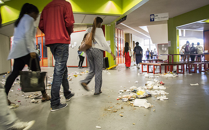 Striking cleaning staff at the University of the Western Cape tipped over bins and left litter strewn over the campus on Monday 22 February 2016. Picture: Aletta Harrison/EWN