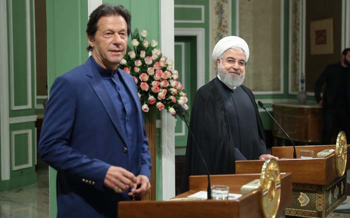 FILE: A handout picture provided by the Iranian Presidency on 13 October 2019 shows President Hassan Rouhani (R) and Pakistan's Prime Minister Imran Khan giving a joint press conference in the Iranian capital Tehran. Khan visited Iran following a request from the United States and Saudi Arabia for him to try to defuse rising tensions in the Gulf. Picture: AFP