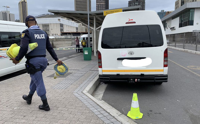 A policeman cordons off an area of the Cape Town station deck following a shooting on 23 November 2020. Picture: Kaylynn Palm/EWN