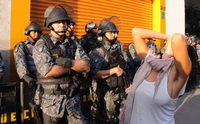While some protesters interrogated cops and bystanders, others stripped. Picture: Christa Eybers/EWN.