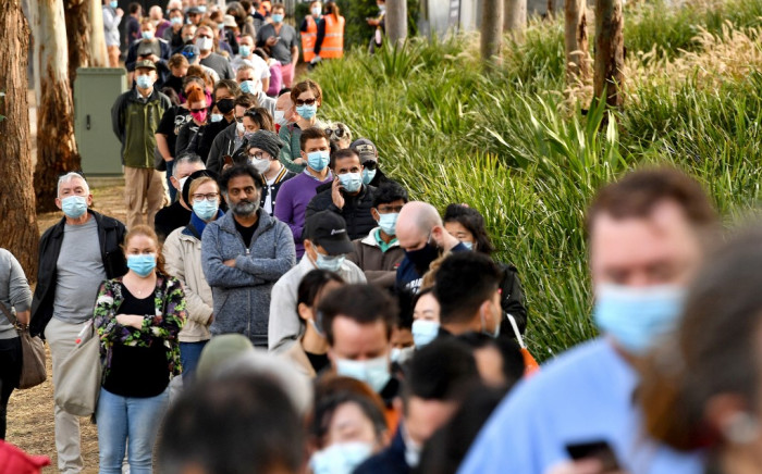 Sydneysiders queue outside a vaccination centre in Sydney on June 24, 2021, as residents were largely banned from leaving the city to stop a growing outbreak of the highly contagious Delta COVID-19 variant spreading to other regions. Picture: AFP: