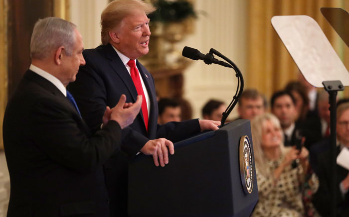 US President Donald Trump speaks during a press conference with Israeli Prime Minister Benjamin Netanyahu (L) in the East Room of the White House on 28 January 2020 in Washington, DC. Picture: AFP