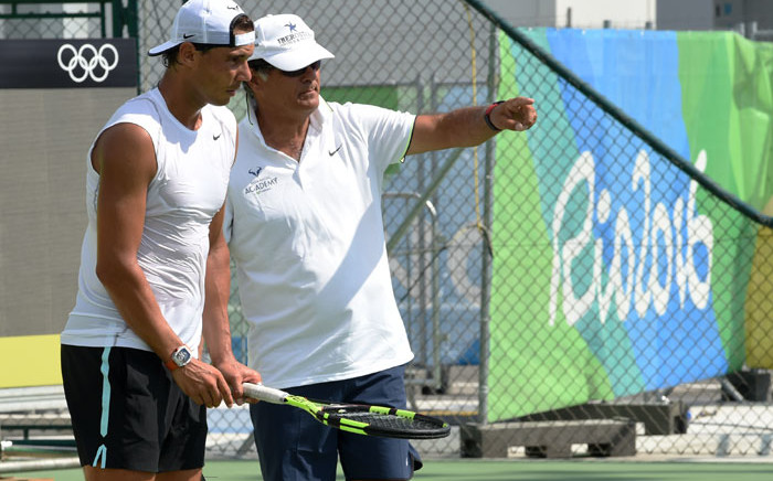 Rafa Nadal (left) listens to his coach and uncle Toni Nadal. Picture: AFP