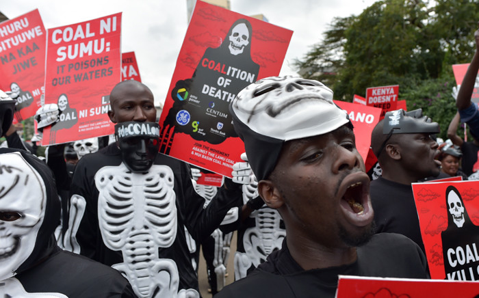 FILE: Activists march on 5 June 2018 in Nairobi carrying placards bearing messages to denounce plans by the Kenyan government to mine coal close to the pristine coastal archipelago of Lamu, on World Environment Day. Picture: AFP.