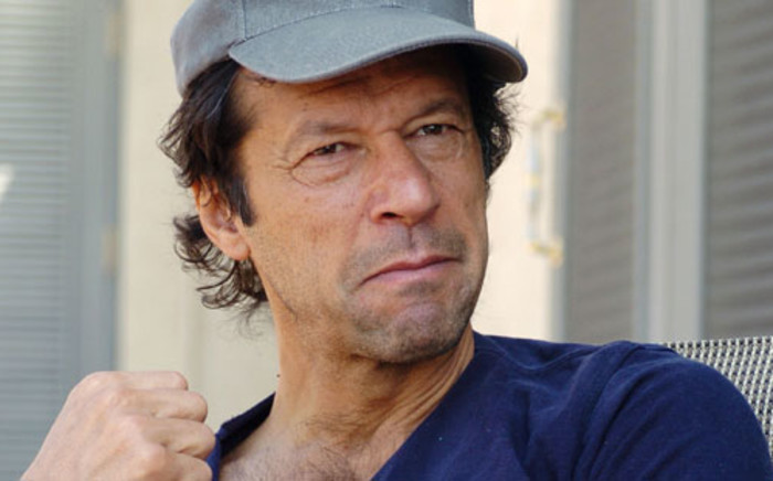Former Pakistan cricket great Imran Khan gives an interview 13 October 2005 in Islamabad. Picture: AFP.