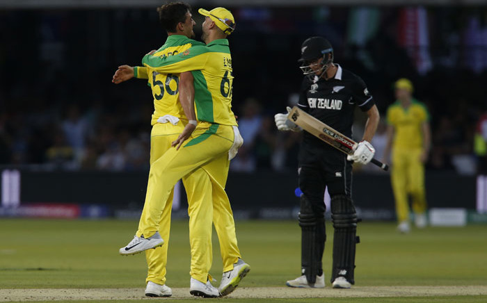 Australia's Mitchell Starc (L) celebrates with Australia's Nathan Lyon after taking the wicket of New Zealand's Mitchell Santner (R) for 12 during the 2019 Cricket World Cup group stage match between New Zealand and Australia at Lord's Cricket Ground in London on 29 June 2019. Picture: AFP
