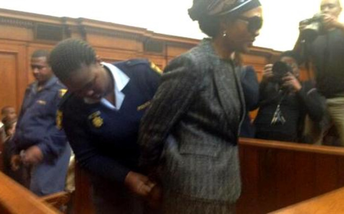 Thandi Maqubela is handcuffed before being led down to a holding cell at the Western Cape High Court on 7 November 2013. Picture: Rahima Essop/EWN