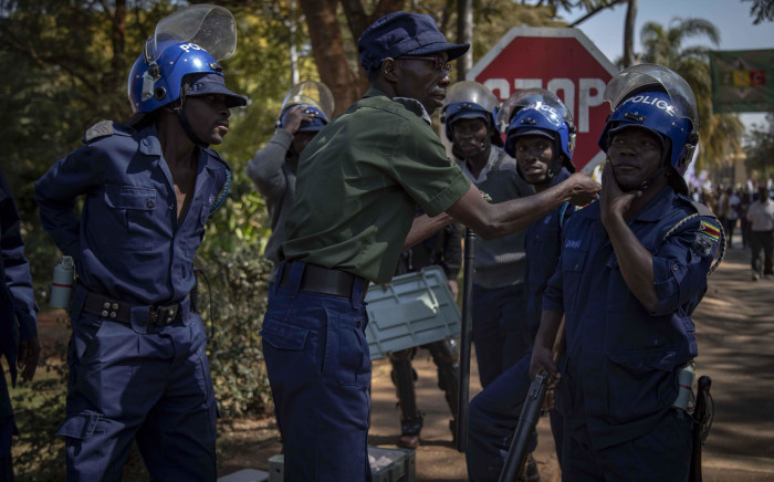 FILE: Protesters marched from the MDC headquarters to the ZEC office at Rainbow Towers, Harare, to protest against the election process on 1 August 2018. They were met by riot police armed with rubber bullets, tear gas, and AKs. Picture: EWN.