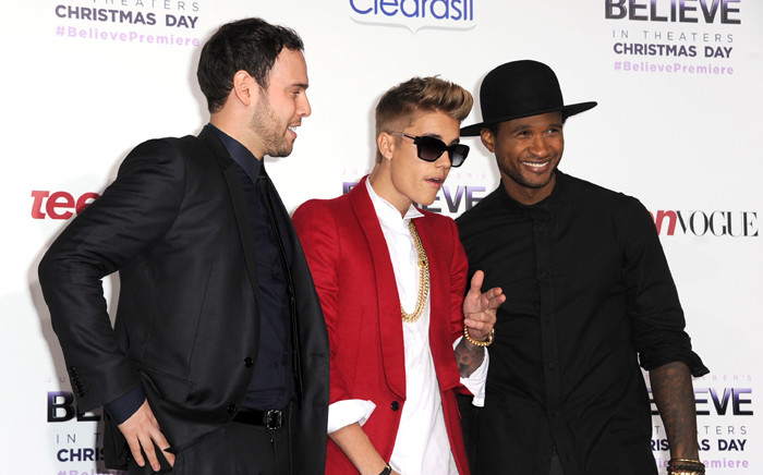 """FILE: Producer Scooter Braun, singer/producer Justin Bieber and producer Usher arrive at the premiere Of Open Road Films' """"Justin Bieber's Believe"""" at Regal Cinemas LA Live on 18 December, 2013 in Los Angeles, California. Picture: AFP."""
