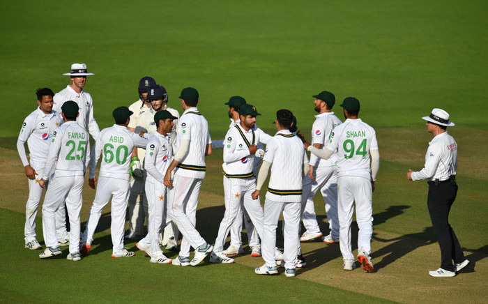 Players and umpires bump arms after agreeing to end the game as a draw on the fifth day of the second Test cricket match between England and Pakistan at the Ageas Bowl in Southampton, southwest England on 17 August 2020. Picture: AFP