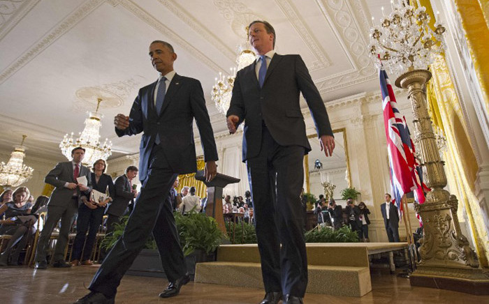 US President Barack Obama(L) and Britain's Prime Minister David Cameron make their way off the stage at the end of a press conference in the East Room of the White House on 16 January, 2015 in Washington, DC. Picture: AFP