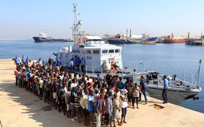 FILE: Illegal migrants from Africa stand in line at a naval base in Tripoli after being rescued by Libyan coastguards in the Mediterranean Sea off the Libyan coast on 29 August 2017. Picture: AFP.