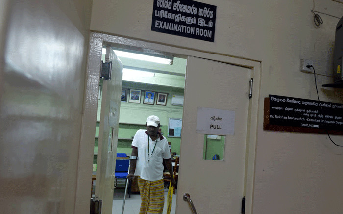 FILE: A Sri Lankan patient walks through a government hospital in Colombo on 30 November 2016. Picture: AFP