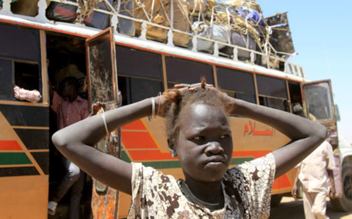 A young South Sudanese girl about to board a bus. Picture: AFP