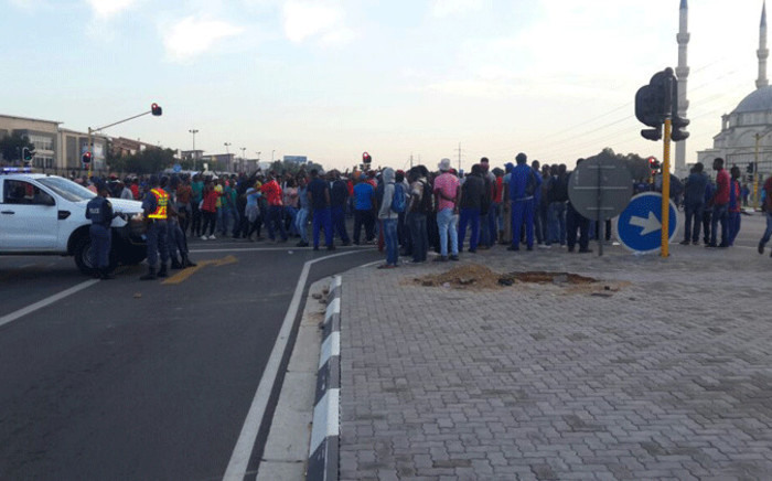 Protesting Dischem workers block the road in Midrand over wage negotiations deadlock. Picture: Supplied.