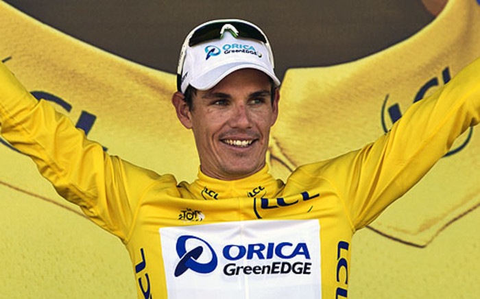 FILE: Daryl Impey celebrates his yellow jersey of overall leader on the podium at the end of the 176.5 km sixth stage of the 100th edition of the Tour de France cycling race on 4 July 2013. Picture: AFP.