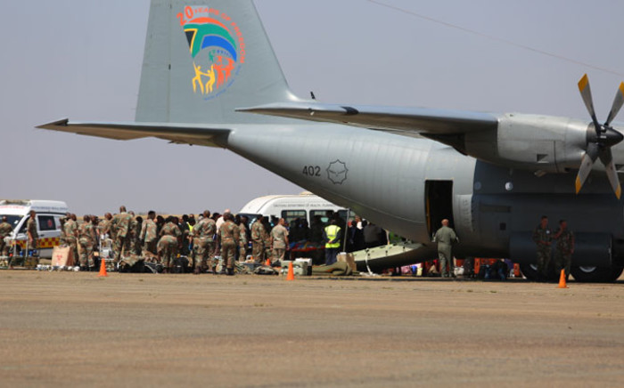 The plane carrying 25 South Africans, including three children, who were injured in the Lagos building collapse more than week ago landed at the Swartkop Air Force Base in Pretoria. Picture: Christa Eybers/EWN