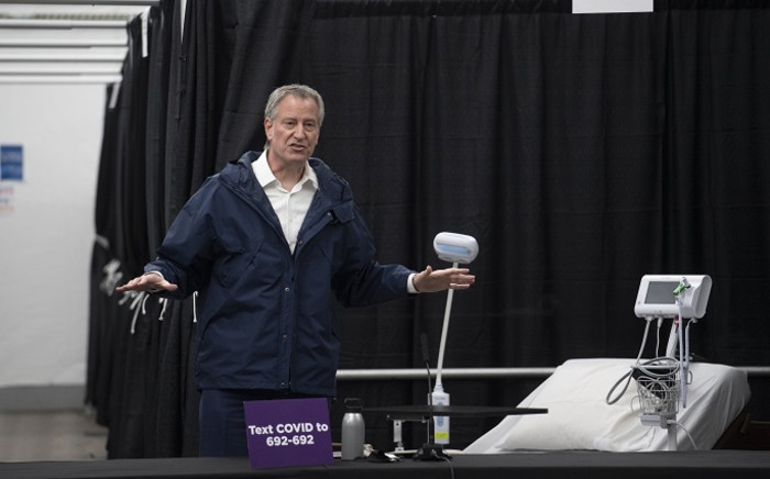 FILE: New York City Mayor Bill De Blasio speaks at a press conference in a temporary hospital located at the USTA Billie Jean King National Tennis Center during the outbreak of the coronavirus disease (COVID-19), in the Queens borough on 10 April 2020 in New York City. Picture: AFP.