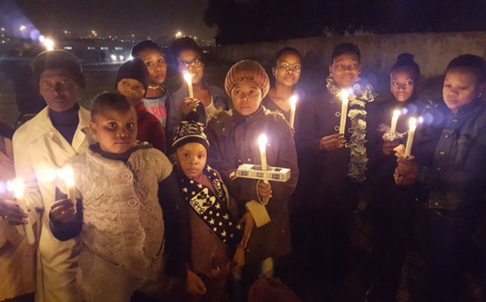 Soweto residents hold a vigil following the rape and murder of Lerato Moloi. Picture: EWN