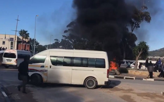 Taxi drivers affiliated to CATA are staging a demonstration in Hout Bay main road. They say Codeta has been allowed to operate on their routes illegally. Picture: Monique Mortlock/EWN