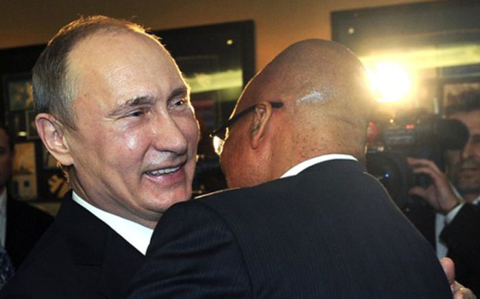 FILE: Russian President Vladimir Putin hugs South Africa President Jacob Zuma before a meeting at the BRICS summit in Durban on 26 March, 2013. Picture: AFP.