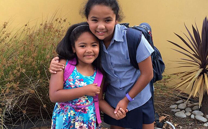 Sisters Cirstie (left) and Tayla prepare for their first day of school on 15 January, 2014. Picture: Theo Esau via Twitter