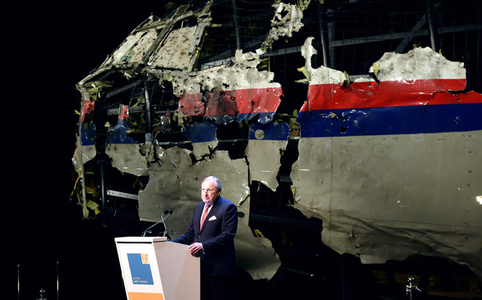 Dutch Safety Board Chairman Tjibbe Joustra speaks in front of the wrecked cockpit of the Malaysia Airlines flight MH17 exhibited during a presentation of the final report on the cause of the its crash at the Gilze Rijen airbase 13 October, 2015. Picture: AFP.