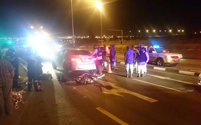 Police on the scene after Satawu's Gauteng secretary Chris Nkosi was shot and killed on 13 April 2015. Picture: @MedixGauteng via Twitter.