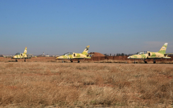 Syrian air forces jets at the Kweyris military air base, in the northern Syrian province of Aleppo, on 11 November 2015. Picture: AFP.