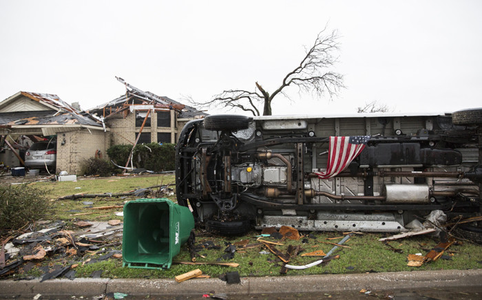 FILE: An American flag placed by first responders is seen 27 December, 2015 in the aftermath of a tornado in Rowlett, Texas. Picture: AFP.