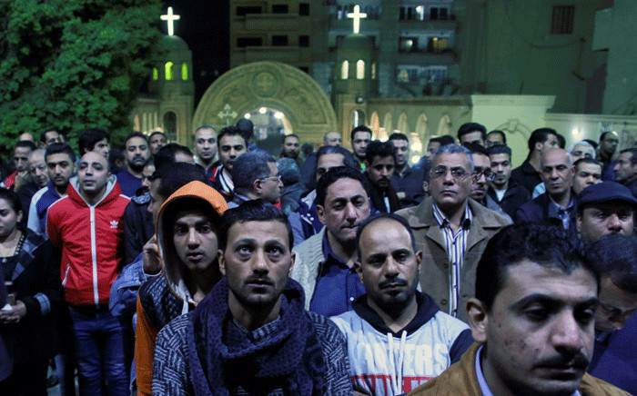 FILE: Egyptians gather during the funeral of the victims of the attack on the Saint Mina Coptic church in 2017 at a church south of the capital Cairo. Picture: AFP.