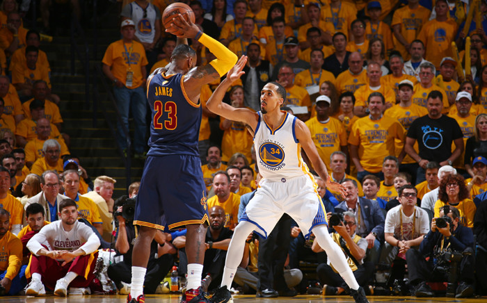LeBron James #23 of the Cleveland Cavaliers is guarded by Shaun Livingston #34 of the Golden State Warriors during Game Five of the 2015 NBA Finals on 14 June, 2015 at Oracle Arena in Oakland, California. Picture: AFP.