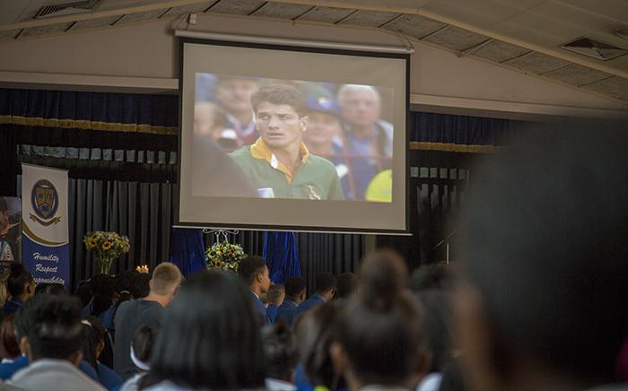 Pupils of FH Odendaal High School in Pretoria watch a memorial video for late Springbok legend Joost van der Westhuizen at a memorial service held at the player's former school on 9 February 2017. Picture: Reinart Toerien/EWN.