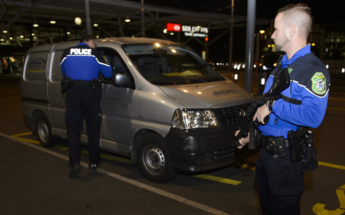 Security forces stop a van at the check vehicles arriving at Genevas airoport on 10 December, 2015, after police raised the alert level and searched the city for several suspected jihadists believed to have links to the Islamic State (IS) group, security sources said. Picture: AFP.