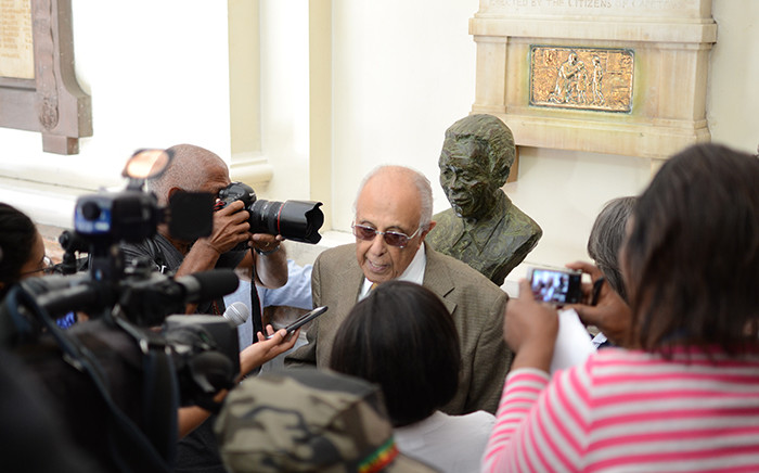 Ahmed Kathrada, politician and previous political prisoner, stands with the new Mandela bust unveiled in Cape Town on Freedom Day. Picture: Anthony Molyneaux/EWN
