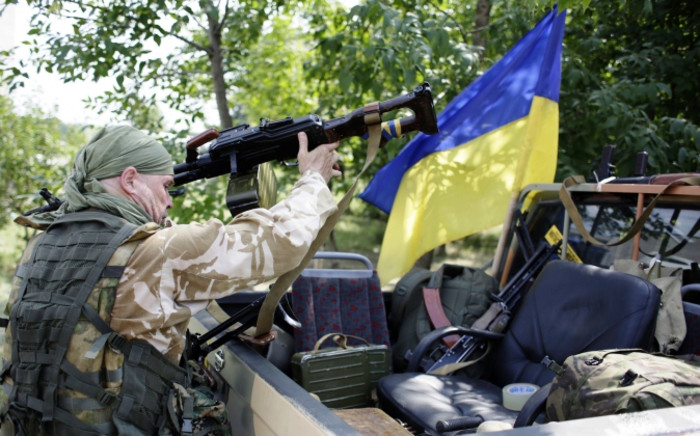 FILE: Ukrainian servicemen on 4 August, 2014 prepare for redeployment from Popasna, Lugansk region, freed by Ukrainian forces from the pro-Russian militants, to Donetsk. Picture:AFP.