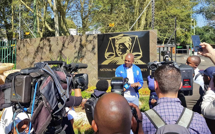 DA leader Mmusi Maimane addresses media outside NPA offices in Pretoria, where he handed over an evidence pack containing allegations the party made against ANC secretary-general Ace Magashule. Picture: @Our_DA/Twitter.