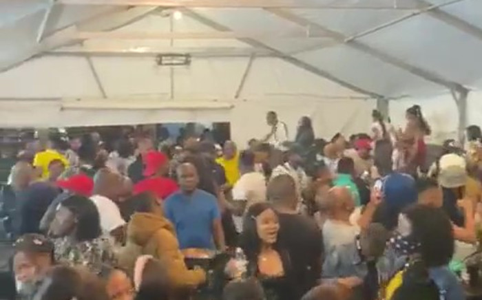 In the video, revellers at an East London venue can be seen downing liquor while maintaining close contact. Picture: Screenshot