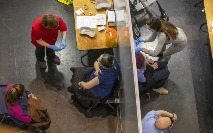 FILE: A general view shows patients being vaccinated with the Pfizer/BioNTech COVID-19 vaccine at a vaccination centre at the Helix on Dublin City University's campus in Dublin on 20 March 2021. Picture: AFP