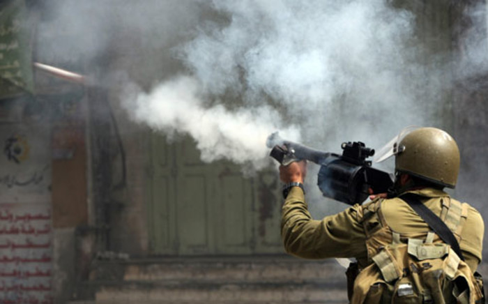 An Israeli soldier fires a tear gas canister during clashes.  Picture: Hazem Bader/AFP.