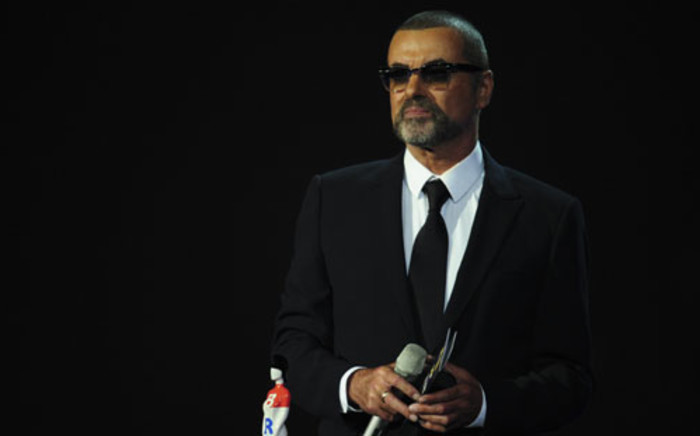 FILE: Singer George Michael presents an award at the Brit Awards 2012 in London on February 21, 2012. Picture: AFP