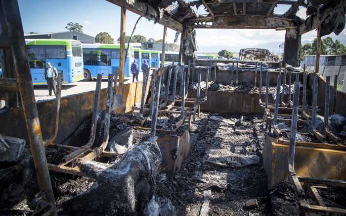 Three of the 4 buses that were torched stand at the depot in George having been recovered. Picture: Thomas Holder/EWN