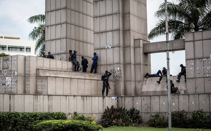 FILE: Congolese police stand around a monument outside the National Independent Electoral Commission(CENI) on 9 January 2019 in Kinshasa, ahead of the possible release of the election results. Picture: AFP.